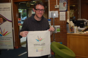 Ollie, our resident librarian, sporting one of our new bags.